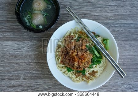 Chicken Noodles Is A Southeast Asian Common Dish Of Seasoned Yellow Wheat Noodles Topped With Diced