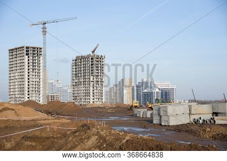 Road Construction At The Large Scale Construction Site On Tower Cranes Background. Installation Of W