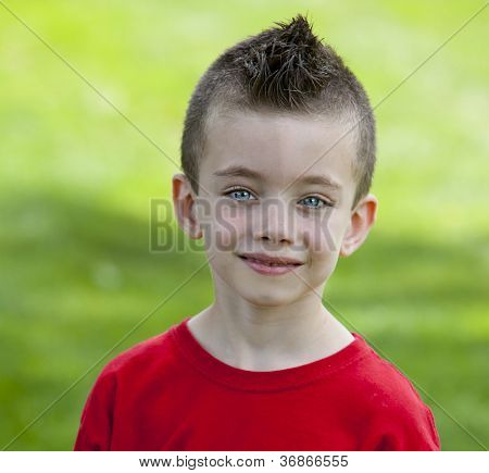 Young Boy In Grass At The Park
