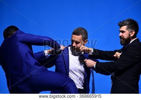 Rivalry And Business Confrontation Concept. Coworkers Decide Upon Best Position