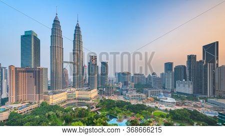 Kuala Lumpur, Malaysia park and skyline at  dusk.