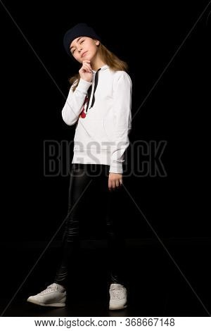 The Concept Of Youth Sports And Clothes.beautiful Little Teenager Girl In A Sports Youth Suit. On A