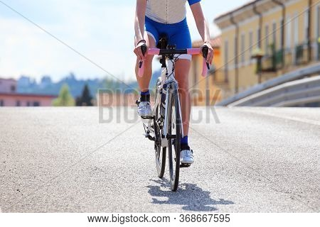 Lonely Professional Cyclist In The Race In The City With The Road Downhill