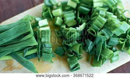 Green Onion - A Feather Representing Onion Leaves. Chopped Green Onions.