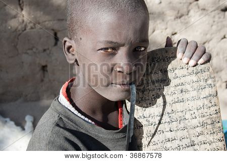 Boy And His Manuscript In Arabic