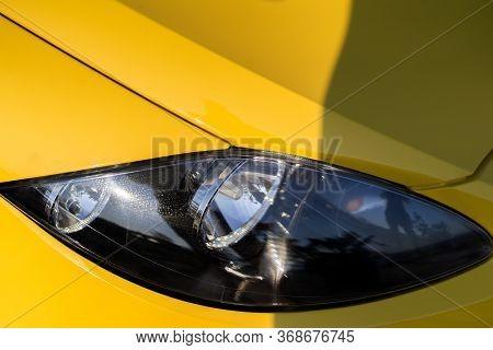 Car Detailing Series: Clean Headlights Of Yellow Sports Car. Car Headlights. Luxury Headlights. Car.