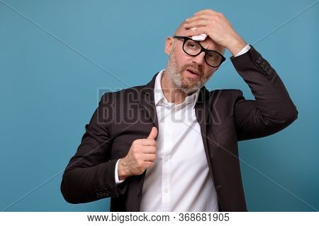 Italian Businessman In Suit And Glasses Wiping Sweat