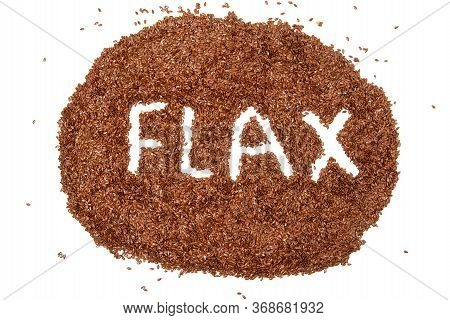 Heap Of Brown Flax Seeds Isolated On White Background With A White Word Flax