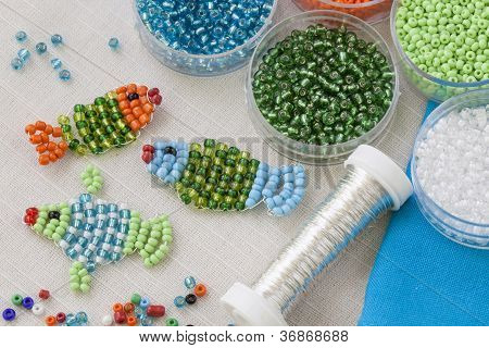 Beaded fishes and colorful beads close up poster