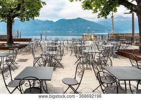 Tables And Chairs Of Street Cafe On Lake Maggiore Lakefront In Luino, Italy