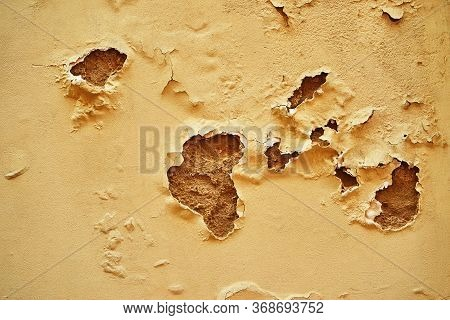 Abstract Exfoliating And Torn Sand Plaster On The Wall For Background And Wallpaper