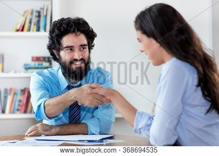 Handshake Of Arabic Businessman And Indian Trainee After Job Interview At Office