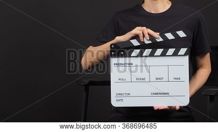 Female Model's Hand Is Holding White Clap Board Or Movie Slate Use In Video Production And Movie Ind