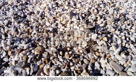 Pebbles On The Beach. Small Multi-colored Pebbles. Natural Background