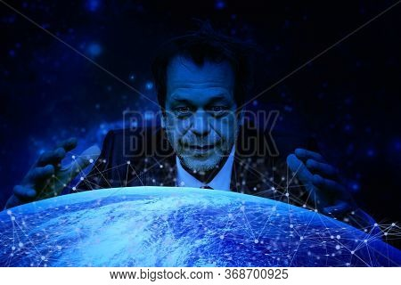 A Man With A Crazy Look On His Face Was Inclined Over The Globe Spreading His Arms. Concept:world Do
