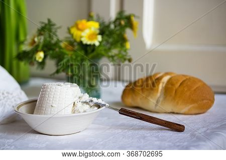 Close Up Of Fresh Italian Ricotta With Wheat Homemade Bread On The Table, Rustic Still Life Composit
