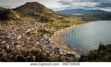 Beautiful Panoramic View In The Sunset In The Titiicaca Lake In Bolivia. City Of Copacabana