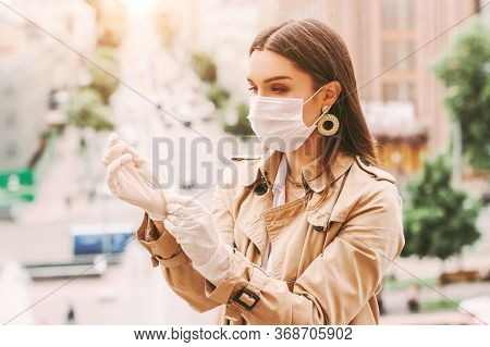 Stylish Woman In Medical Face Mask Wear Protective Latex Gloves On City Street. Beautiful Elegant Hi