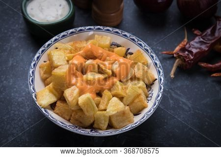 Patatas bravas, spanish fried potato as served in tapas bar