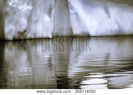Black And White Snowing Floating Iceberg Reflection Abstract, Paradise Bay Skintorp Cove Antarctica.