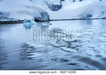 Snowing Blue Mountains Reflection Paradise Bay Skintorp Cove Antarctica. Glacier Ice Blue Because Ai