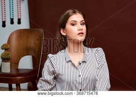 Gorgeous Young Female In Classic Suit, Black Shoes And Grey Coat. Vintage Chair. Womans Clothes.