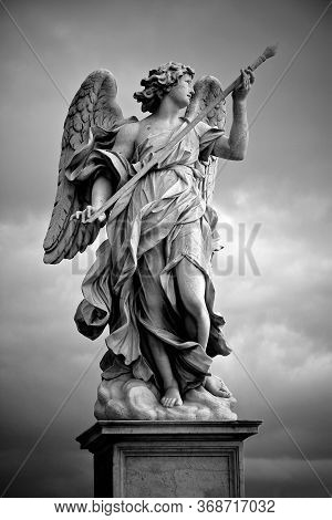 Berninis Marble Statue Of Angel From The Santangelo Bridge In Rome, Italy. Hight Quality Photo