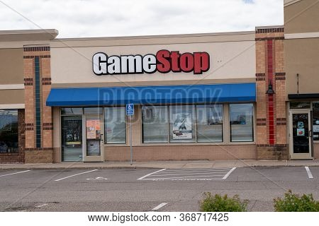 Minneapolis, Minnesota - May 29, 2020: A Gamestop Video Game Store Is Barricaded And Boarded Up To P