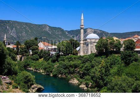 Mostar, Bosnia And Herzegovina - July 11, 2019: Scenic View From Mostar Bridge Of The Neretva River