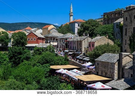 Mostar, Bosnia And Herzegovina - July 11, 2019: Scenic View From Mostar Bridge Of The Old City Of Mo