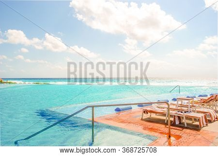 Big Infinity Pool With Salt Water In The Caribbean Sea In Bright Sunny Afternoon. Summer Tropical Oc