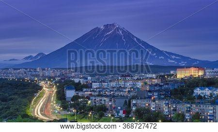 Panorama Of Night City Of Petropavlovsk-kamchatsky On Background Cone Of Volcano, Urban Development
