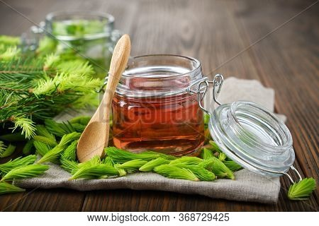 Jar Of  Jam, Syrup Or Honey From Fir Buds And Needles, Twigs Of Fir Tree On Wooden Table. Making Spr
