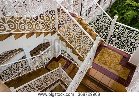 staircase with  wrought iron fence  top view after rain photo taken  in  Dominican Republic