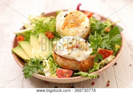vegetable salad with bread and goat cheese