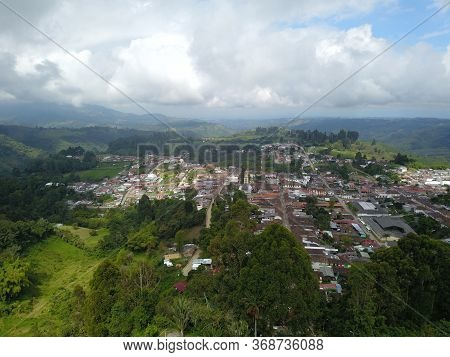 Aerial View Of The Town Of Salento, Around The Mountains In The Coffee Axis Of Colombia