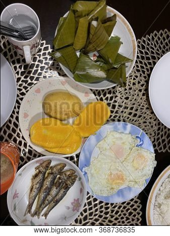 Photo Of A Typical Filipino Breakfast With Slices Of Philippine Mango Fruit, Suman, A  Filipino Rice