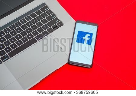 Tula, Russia - May 18,2020: Modern Smartphone With Facebook Logo On The Screen.