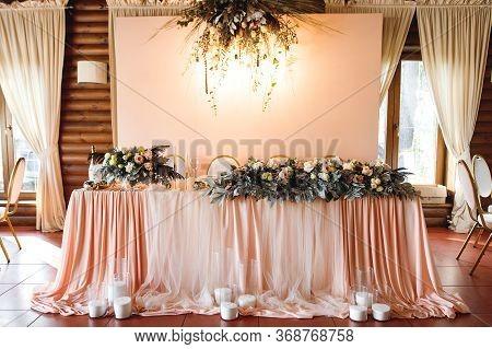 The Presidium With Fresh Flowers Of The Newlyweds At The Wedding