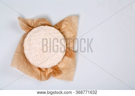 The Concept Of Oriental Cuisine. National Italian French Brie Type Of Cheese On Kraft Paper, Cheese
