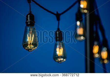 Grunge Lamps On A Wire. Steampunk Vintage Lighting Decor. Elegant Modern Light Bulb.