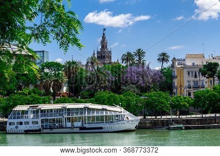 Sevilla, Andalusia, Spain  - 14 May 2013: Сruise Ship On The Promenade Of Guadalquivir With The Gira