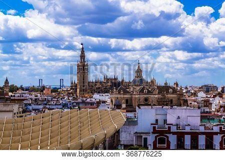 Sevilla, Andalusia, Spain  - 14 May 2013: View At The Cathedral Of Sevilla With Giralda From Metropo