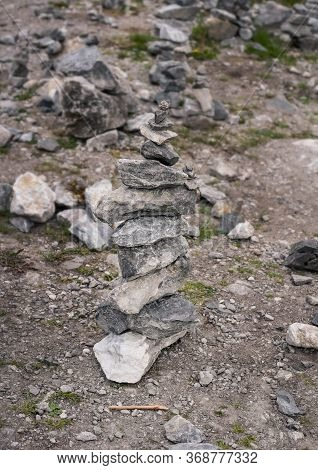 Turret Of Gray Stones Surrounded By Stones