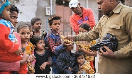Agra, India - December 12, 2018: Banana Treats For Children From Poor Areas Of Agra City.