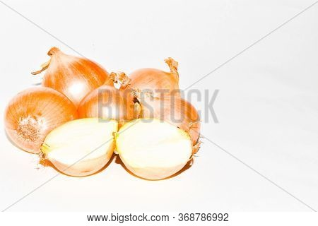 Fresh And Chopped Onions On A White Background. Onions For Cooking. Onions Of Different Sizes. Place