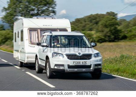 Isle Of Skye, Scotland - August 3, 2019: The Abstract Image Of Skoda Yeti Suv Car Towing A Caravan W