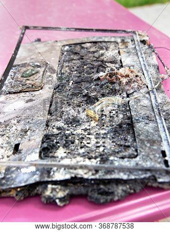 Destroyed Notebook, Melted Plastic. Computer Damage