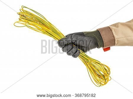 Skein Of Yellow And Green Solid Grounding Wire In Electrician Hand In Black Protective Glove And Bro