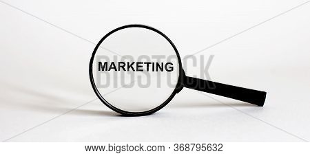 Magnifier With Text Marketing On The White Background